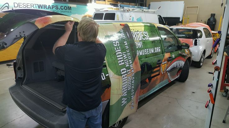 Mark installing a high quality vinyl wrap on a van to promote the Palm Springs Air Museum located in Palm Springs, CA. Contact DesertWraps.com at 760-935-3600. #VanWrap #VinylWrap #PalmSprings #PalmSpringsAirMuseum #PalmDesert #VehicleWrap
