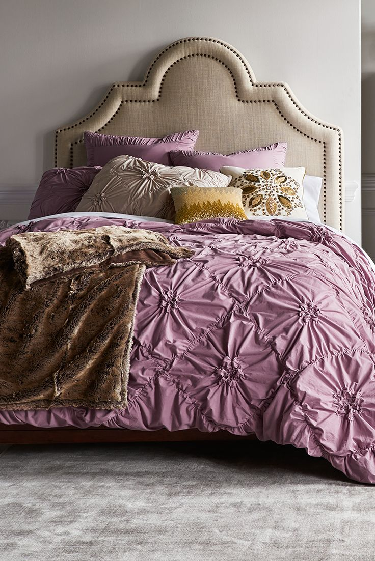 Pier 1's ruched Savannah bedding in deep lilac gathers