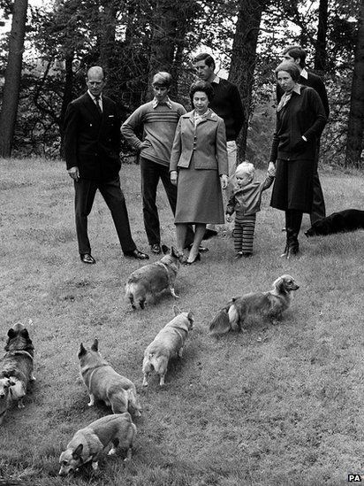 The Queen, Duke of Edinburgh and their family, enjoying a stroll with their dogs in the grounds of Balmoral Castle, in 1979 #corgi