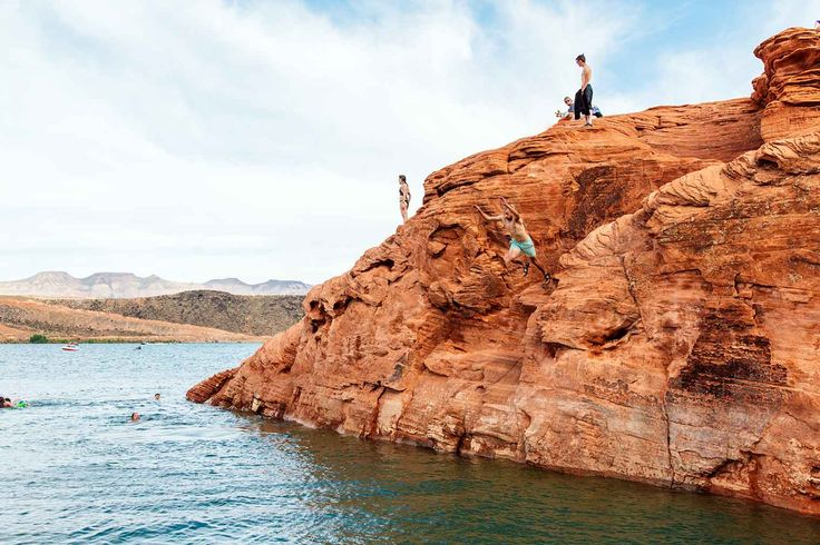 Cliff jumping into the warm waters of Sand Hollow State Park, just outside of St. George, Utah