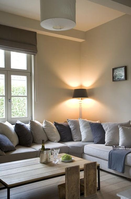 I love those cushions and corner sofas.