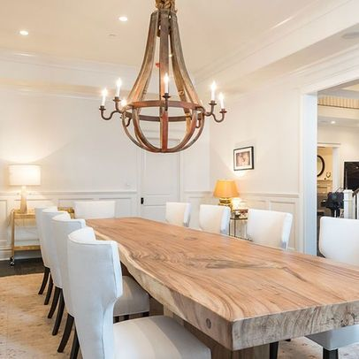 Natural wood dining room table with wine barrel stave chandalier. Rustic french country dining room