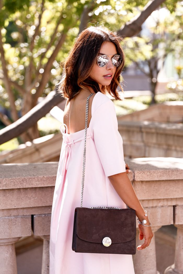 And so the dress craze continues... My latest obsession, this lovely pink trapeze number from Paul & Joe Sister. The color and side poc...