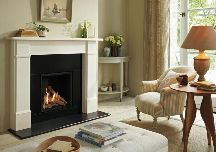 THE ALCHEMY GFP 500 GAS FIRE With its portrait sized proportions the Alchemy GFP 500 is ideally suited as the interior to a fire surround. The Alchemy GFP 500 is shown here inside the Classic Victorian limestone surround with a black slate hearth and slips and black interior panels accentuating the generous flame patterns.