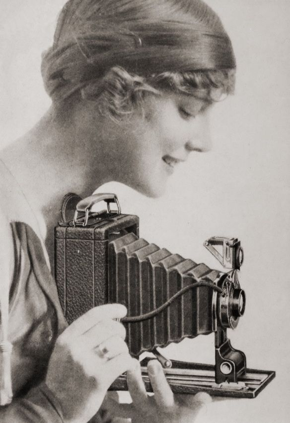 """Love """"The Girl's"""" expression. Beautiful camera! Repinned from Katie Bedlow: Girl with Kodak camera (c1910)"""
