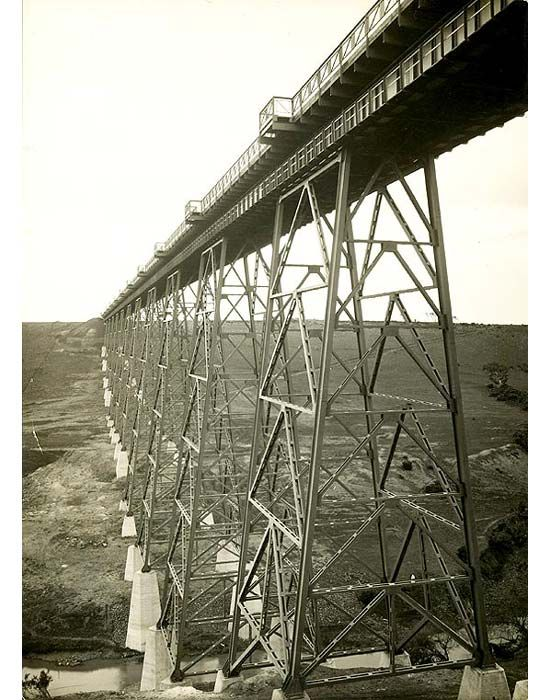 Inscription: Albion Broadmeadows Line. Maribyrnong River Viaduct. 1929. Description: Looking up and along the Maribyrnong River Viaduct. The span appears to be complete. Location: Keilor East, Victoria, Australia Date: 1929