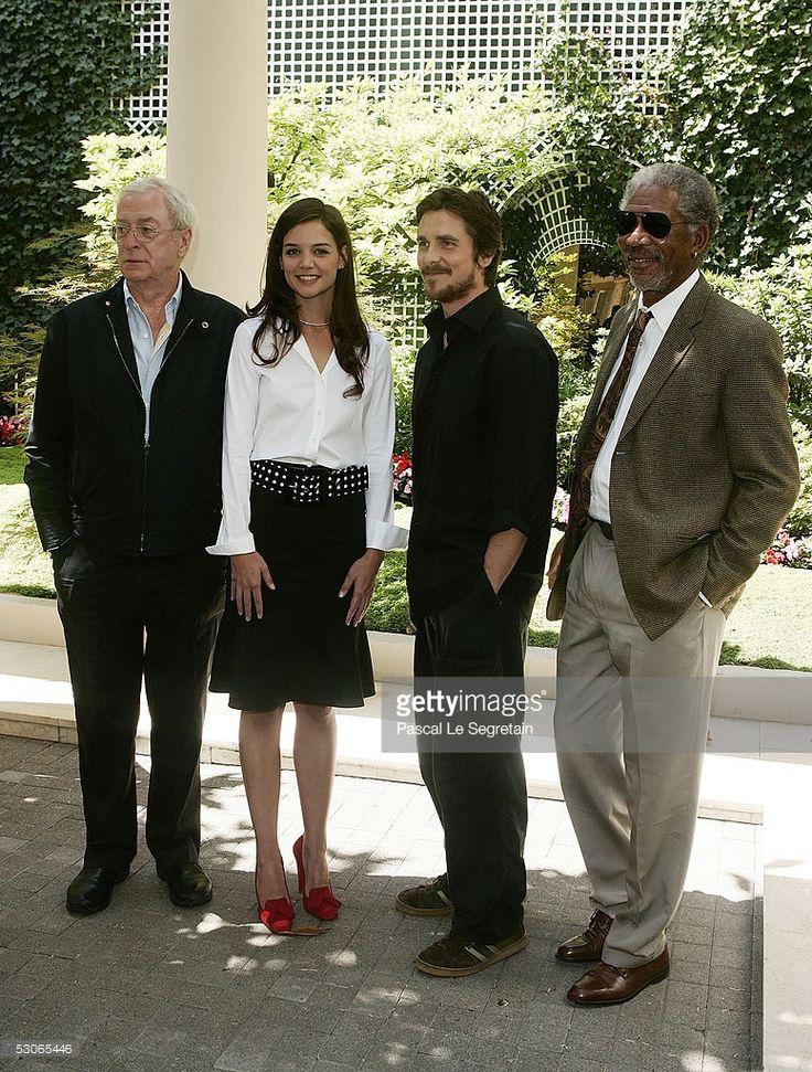 Actress Katie Holmes poses with actors Michael Caine(L) Christian Bale and Morgan Freeman(R) during a photocall for Batman begins on June 14, 2005 in Paris, France.