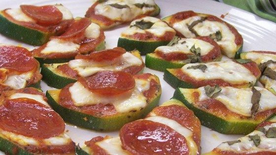 Large zucchini rounds topped with pizza sauce and cheese, then cooked on the grill.