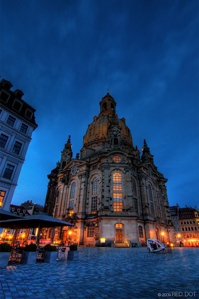 Dresden's iconic Church of Our Lady under blue hour sky. Germany