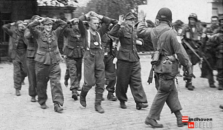 Liberation of Eindhoven, The Netherlands. US soldiers with German POW's.