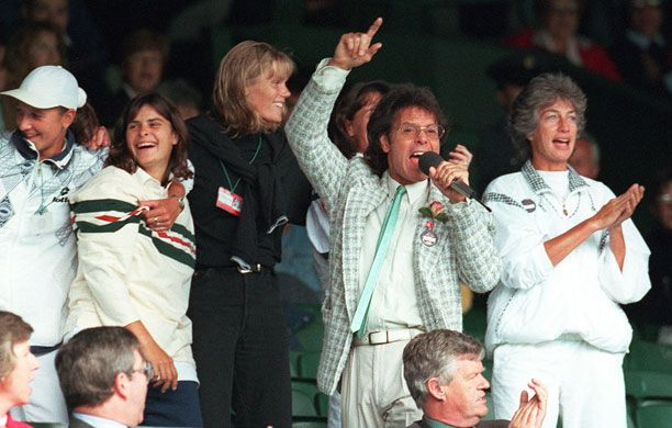 The 20 best Wimbledon moments | gallery - #16: Cliff and the raquettes, 1996: Sir Cliff Richard entertains the drenched masses, with hacming vocals provided by Martina Navratilova, Pam Shriver, Hana Mandlikova, and Virginia Wade: All together now: We're all going on a.....
