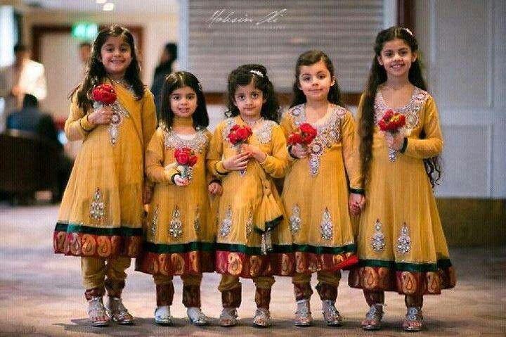 girls in mustard Pakistani frocks
