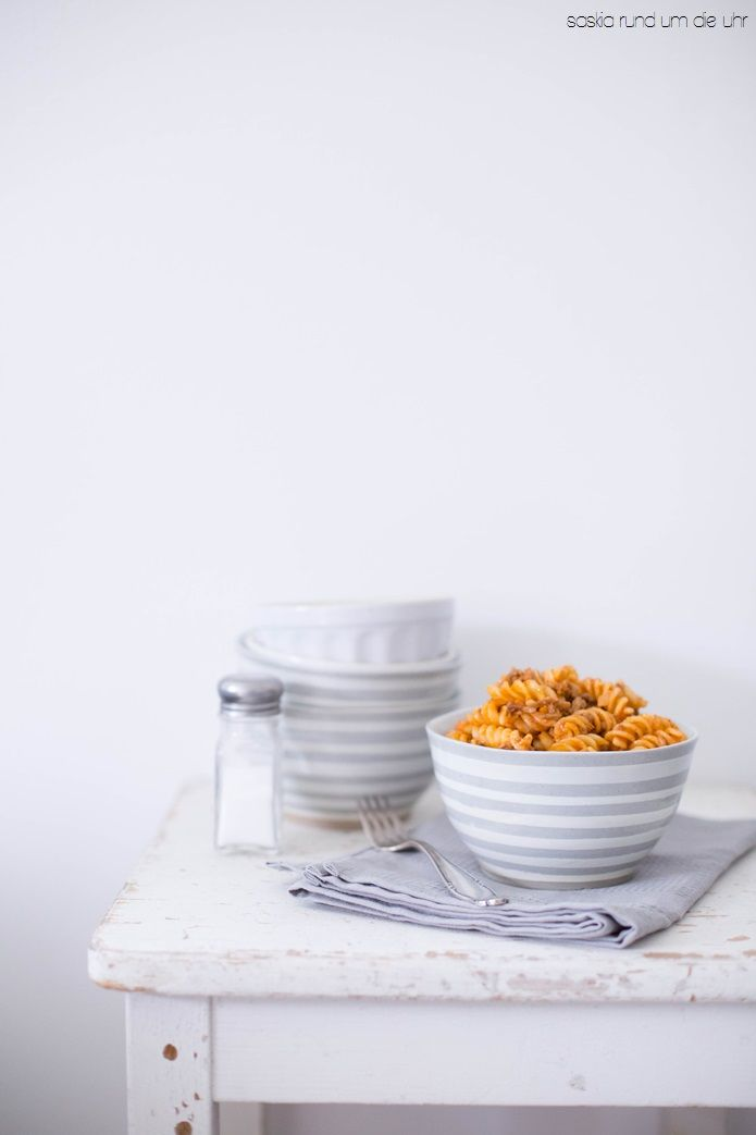 Fusilli with meat sauce. Grey and white ceramic