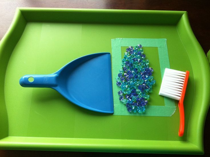 TEACH Fine Motor Skills.  It's a great idea to have several little brooms and dustpans in your preschool classroom or home.  Kids love using them!