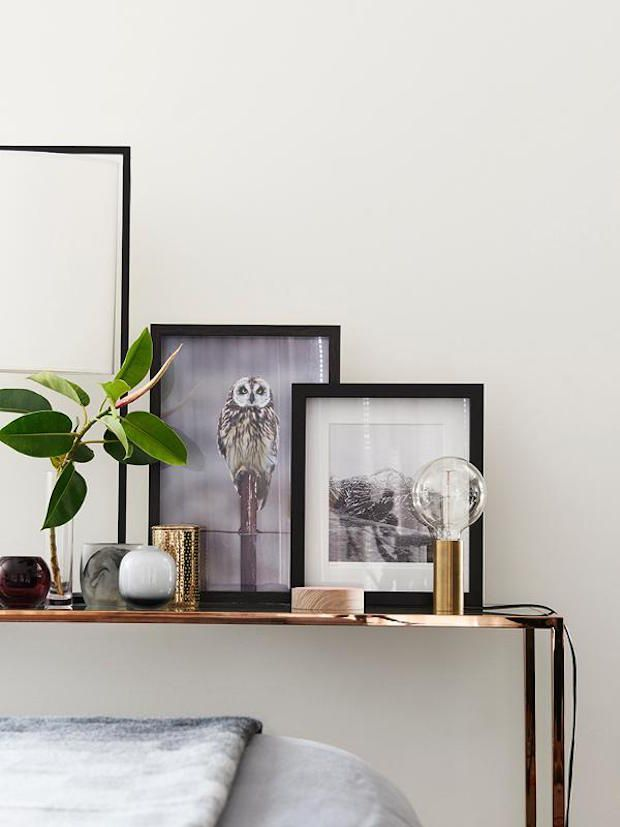 Monochrome, brass and mid-century  in a sophisticated home. Designer: Lauren macer. Photo: Eve Wilson. Styling: Studio Moore.