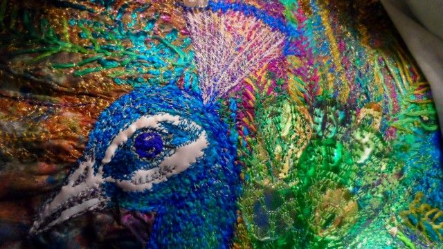 Peacock embroidery with fme and applique.