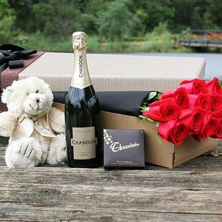 """Buy """"The Big Kahuna"""" for $155.95. If You Want To Go All Out To Express Your Love, This Is The Gift To Do It With. It Has It All - Red Roses, Bubbles, Chocolate And A Super Cute Teddy Bear. One Dozen Magnificent Long Stem Roses Are Exquisitely Nestled In Our Signature Gift Box And Accompanied By A Sweet Little 40g Box Of Chocolatier Treats, A Bottle Of Chandon Sparkling Wine (or Moet Et Chandon) And One Rather Handsome Bear. Simply Place Your Order Via Our Online Florist Shop Or Call Us Toll…"""