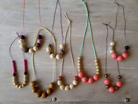 chunky wooden bead necklace made with five 30mm dark varnished beads that you can see their beautiful grains  the cord is thick made from