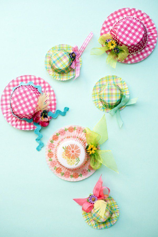EASTER HAT FAVORS DIY. Glue cardstock to the cupcake liner with beautiful patterns to make it stronger. Glue the cupcake liner filled with candy to the one with cardstock. Attaching some decorations such as ribbons or bows to make it more beautiful.