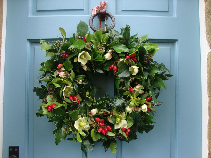 Christmas wreath with rosehips, holly and hellebores