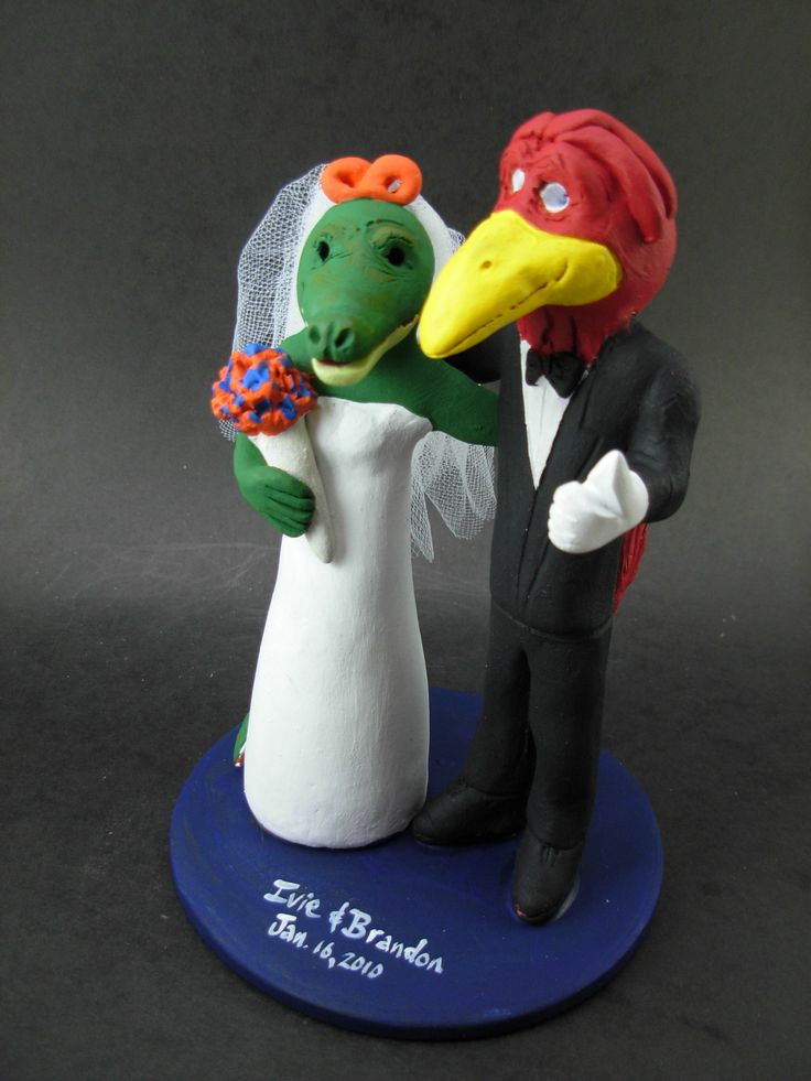 Custom made to order Cardinal and Alligator college mascot wedding cake toppers. $235 www.magicmud.com 1 800 231 9814 magicmud@magicmud... blog.magicmud.com twitter.com/... $235 #mascot #collegemascot #hokie #ms.wuf #gators #virginiatech #football mascot #wedding #toppers #custom #Groom #bride #weddingcaketoppers #caketoppers www.facebook.com/... www.tumblr.com/... instagram.com/... magicmud.com/Wedding photos.htm