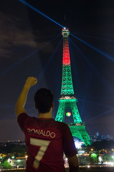 #EURO2016 The Eiffel tower is lit up in the colors representing Portugal for the 'EURO 2016' Twitter contest organized by French telecom operator 'Orange' at...