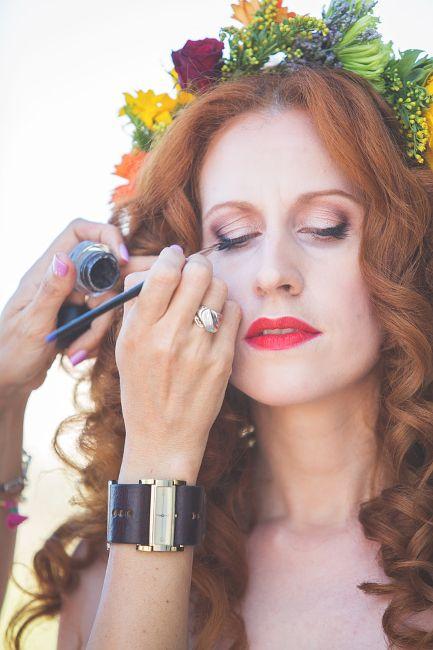 Boho-chic bridal makeup featuring red lipstick & natural curls by Antigoni Livieratou. Photography by Irini Koronaki