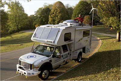 Brian Brawdy's Lance 1191 Truck Camper featuring six solar panels,  wind turbine, and rain water collection system
