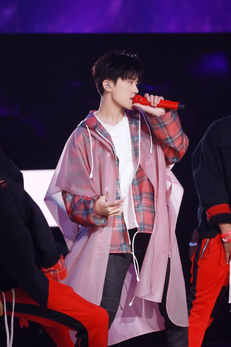 Singer #YiyangQianxi wearing a Burberry tartan cagoule and soft-touch plastic poncho at the Hunan TV New Year's Eve Party