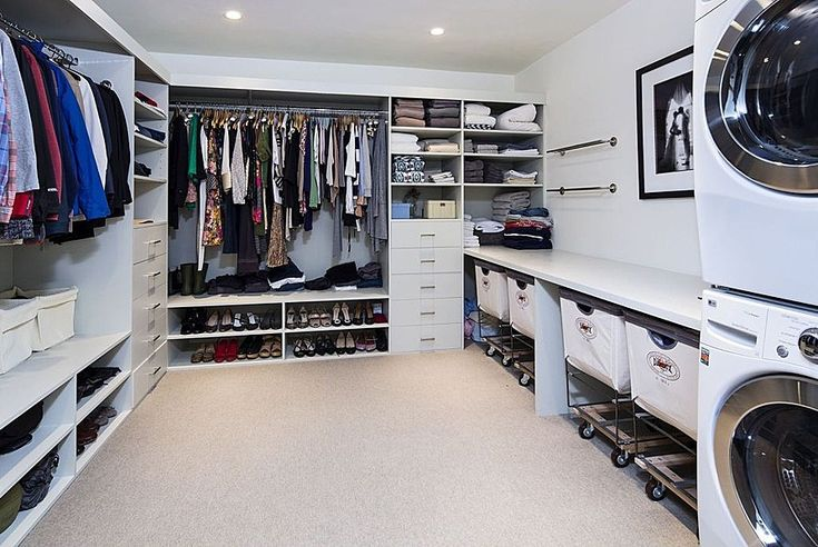 Modern Closet with Custom closet storage, Laminate floors, can lights, Standard height, Steele divided canvas sorter