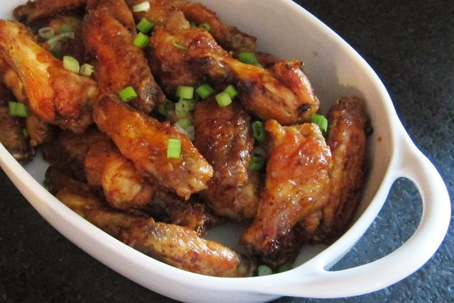 Recipe for baked chicken wings with a tasty tangy sauce. Try this recipe for chicken wings and plan to marinate them for about an hour before cooking.