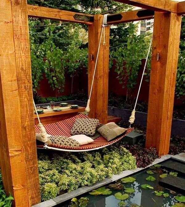 Wooden garden swing made with railway sleepers