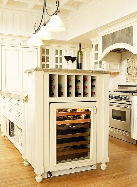 Love the wine storage and cookbook rack in the island.