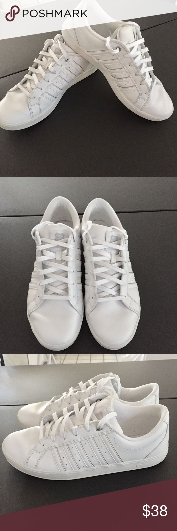 """Men's """"K Swiss"""" white Great pair of men's """"K Swiss"""" low, white sneakers. These shoes are in great shape with very little wear,  minor flaw one label is slightly unraveled see last photo. K-Swiss Shoes Sneakers"""