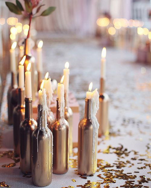 Spray paint your used wine bottles for a seriously chic, yet seriously cheap candlestick