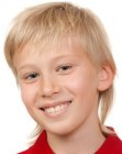 Mullet look for young boys. Haircut with a short front and a longer back area. More hairstyles for boys: http://www.hairfinder.com/kidshairstyles/hairstyles_for_boys.htm