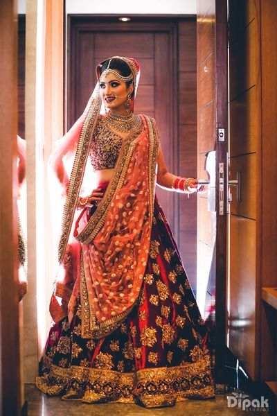 Bridal Wear - Velvet Marsala Wedding Lehenga with Pink Net Dupatta | WedMeGood #wedmegood #indianbride #bridal #indianwedding #lehenga #marsala #weddingoutfits