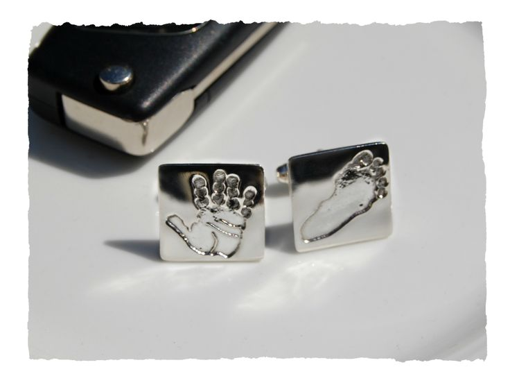 Have a set of elegant cufflinks with your loved one's hand or footprint.  These cufflinks will dress up any suit and make a stylish impression.