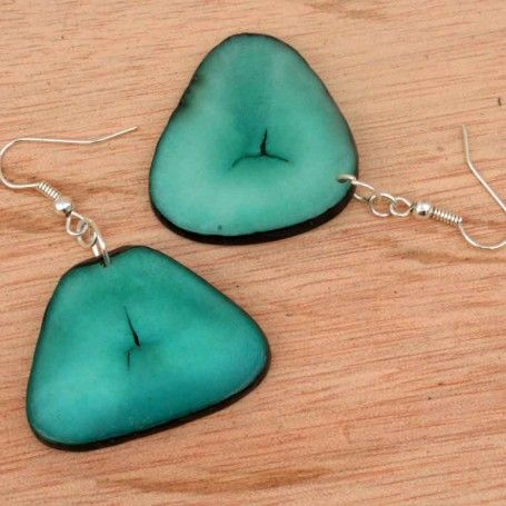 Check out these lovely minty green beaded earrings. The gentle color and natural striations will add a unique organic look to any casual outfit. $25.00 http://www.artisansintheandes.com/beaded-earrings-green-dangling/beaded-earrings-dangling-green-tagua-slice
