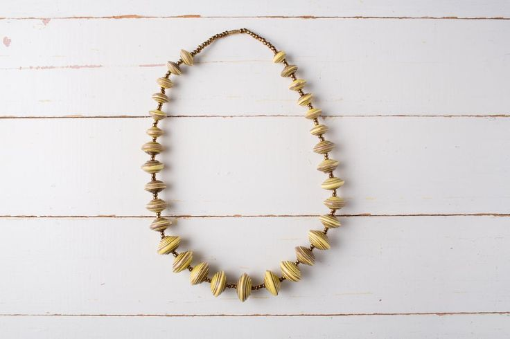 Nambalaba   Africa, ethical, jewellery A graduated statement necklace – classic and elegant.      Made with recycled paper beads     Length: 25cm approx.     Available in 4 colours     New colours coming soon - red and blue!  Each piece of Zurii jewellery is unique, and handmade in Uganda. Variations may occur in colour, length and size, which adds to the individuality and beauty of the piece.