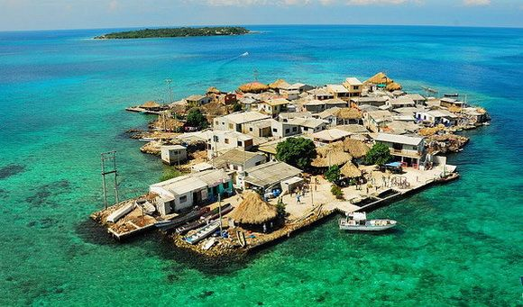 The most densely populated island in the world is Santa Cruz del Islote, a microslum off the coast of Colombia. This tropical island is located in the emerald waters of the idyllic Caribbean, though is packed so tight that most activities are done off island.