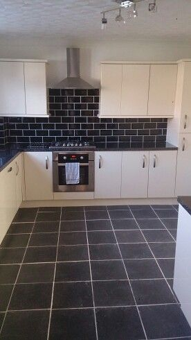 After a 7 year wait, new kitchen installed! Cream gloss slab, with Astral black worktops and black gloss brick tiles. Worth the wait!! From B&Q I.T range.