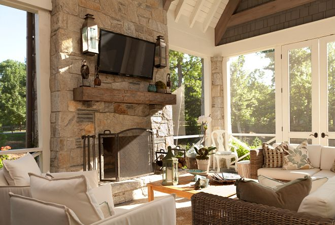 Screened in porch with fireplace. The screened-in porch is as comfort as any other room in the house. T.S. Adams Studio. Interiors by Mary McWilliams from Mary Mac & Co.