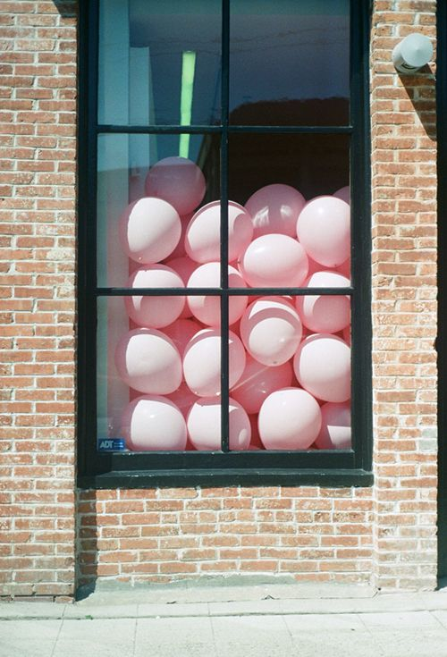 Balloons, cute way to create anticipation for store opening...