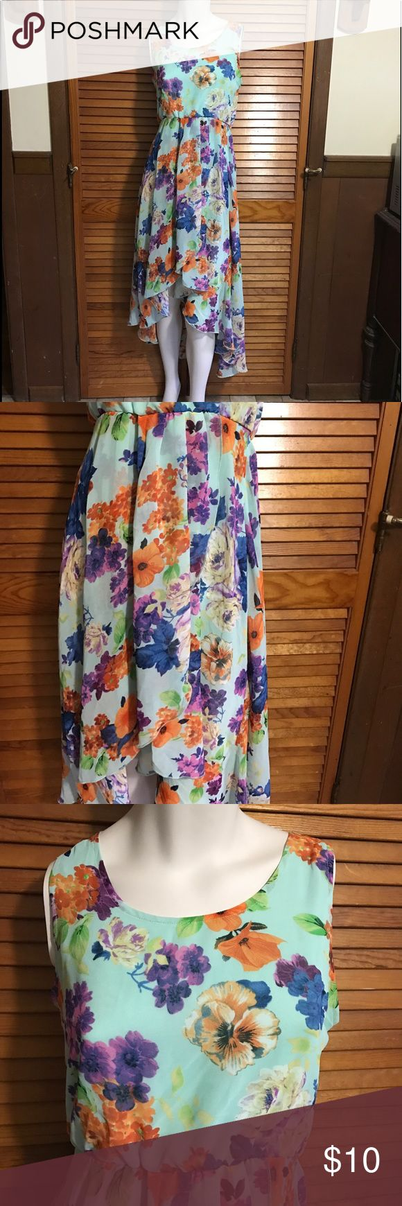 High low ruffled sleeveless floral dress medium Women's high low sleeveless ruffled dress size medium. Excellent used condition- no rips/stains/holes etc. whispers Dresses High Low