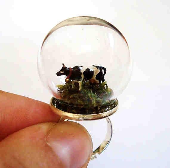 grazing cow ring. miniature grass animal snow globe. TinyTastyJewelryCafe. etsy.
