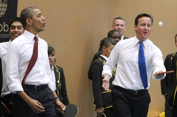 Obama and Prime Minister David Cameron played table tennis at the Globe Academy in London, Tuesday.