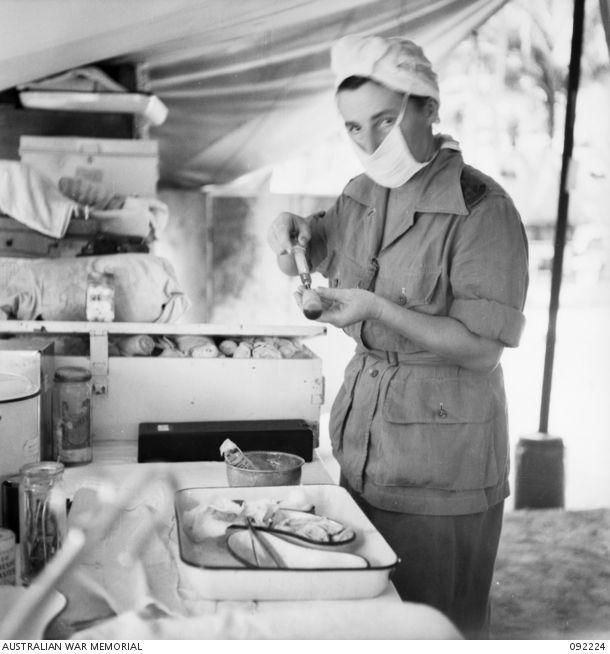 MOROTAI. 1945-05-16. LIEUTENANT A.H.F. MCCULLOCH AUSTRALIAN ARMY NURSING SERVICE, 2/5 GENERAL HOSPITAL, PREPARING A PENICILLIN INJECTION. - Australian War Memorial