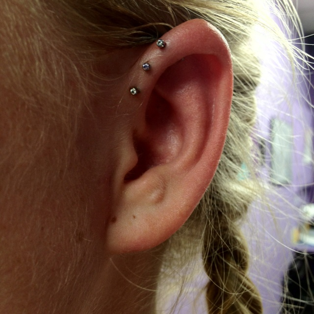 Triple front helix piercings with neometal push pin gem studs