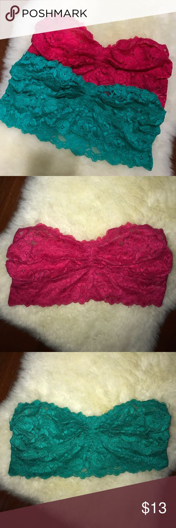 Floral Lace Bandeau Tops Perfect for any festival outings or beach parties! Colorful, comfy & sexy, these tops will stand out. Size Large but can fit a B/C cup. I am a size 36D & these fit perfect & give my girlies a little lift. Worn each one once for EDC & EZOO festivals. Washed. This includes both pink & turquoise tops together, please contact me if you want to buy one separately. Foxy Lady Tops Crop Tops
